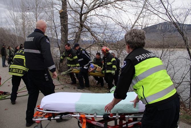 A man rescued from the shore of the North Thompson River was wrapped in blankets and pulled up the embankment this afternoon, March 9, 2016.