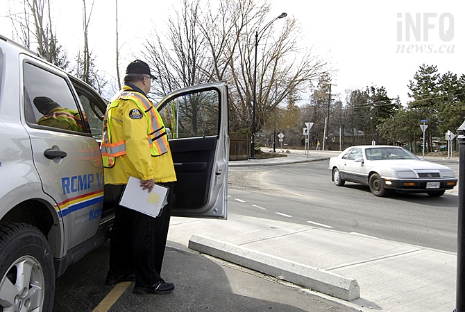 Gary Toneff is one of the volunteers helping warn distracted drivers before they get ticketed.