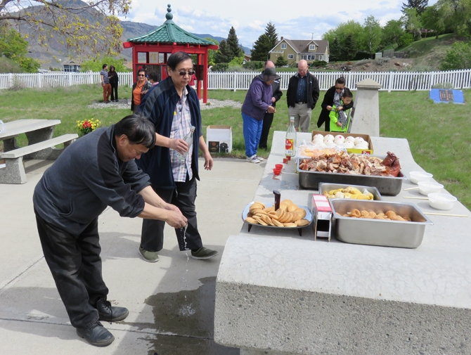 Wine being offered at the 2015 Ching Ming ceremony at the Kamloops Chinese cemetery.