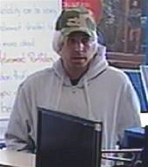Police are looking for this man after a robbery at the Bank of Montreal in Salmon Arm March 23, 2016.