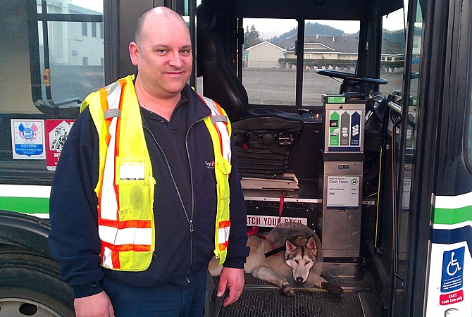 Kelowna bus driver Clayton Bouchard and Shadow, an injured dog that boarded his #11 bus Thursday morning.