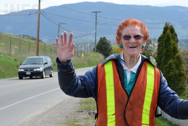 Helen Sidney, 93, waves to passersby on Bella Vista Road in Vernon.