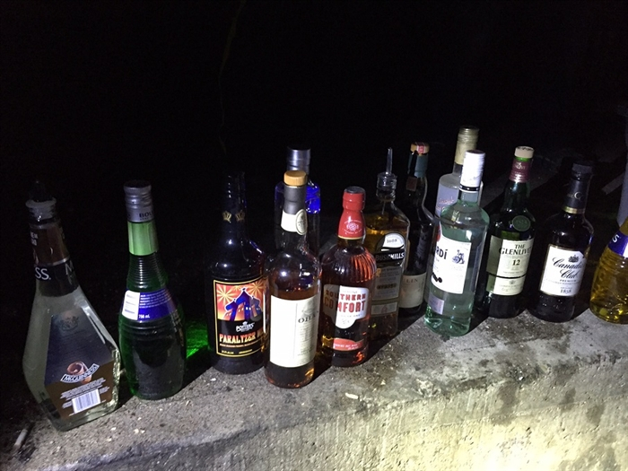 Pictured are the bottles of liquor recovered by RCMP following a break, enter and theft at the Barley Mill Brew Pub in Penticton, Friday, April 22, 2016.