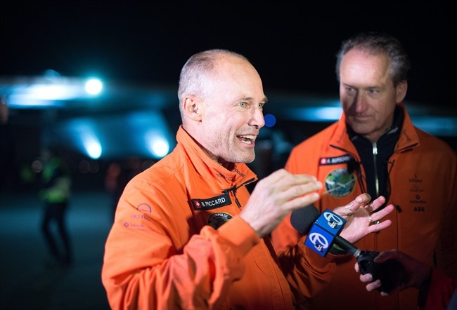 Solar Impulse 2 pilots Bertrand Piccard, left, and Andre Borschberg speak with reporters after their solar-powered plane landed at Moffett field in Mountain View, Calif., on Saturday, April 23, 2016.