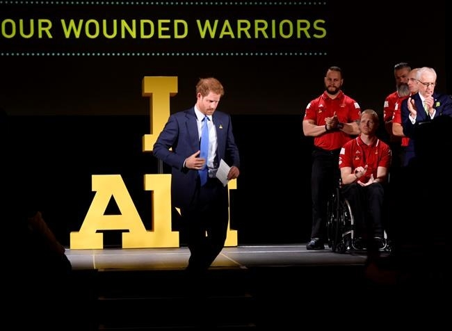 Prince Harry receives applause as he walks off the stage after delivering a speech to assembled guests during a ceremony to promote the 2017 Invictus Games, which the city will be hosting, in Toronto on Monday, May 2, 2016.