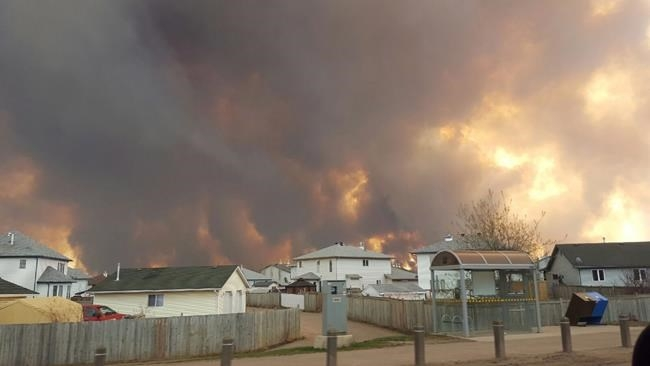 A wall of fire rages outside of Fort McMurray, Alta. on Tuesday, May 3, 2016.