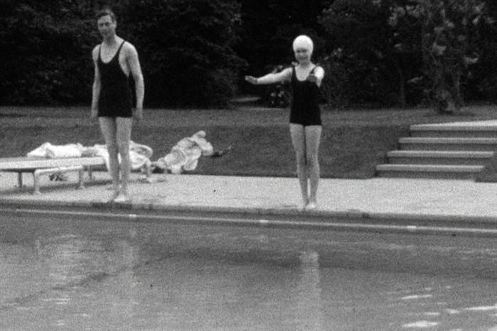 This undated handout photo provided by HM The Queen shows the then Princess Elizabeth swimming with her father, King George VI in Britain.