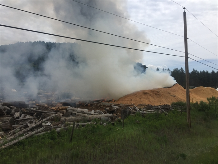According to witness Rob Ellis, the fire burned the mill to the ground and made its way into a large sawdust pile.