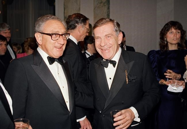 FILE PHOTO - In this March 3, 1988 file photo, Henry Kissinger, left, and Morley Safer of CBS'