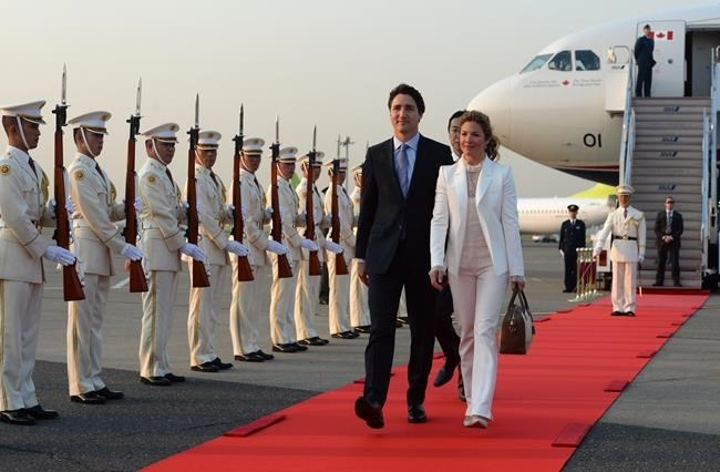 FILE PHOTO - Prime Minister Justin Trudeau and his wife Sophie Gregoire Trudeau are greeted by an honour guard as they arrive in Tokyo, Japan on Monday, May 23, 2016.