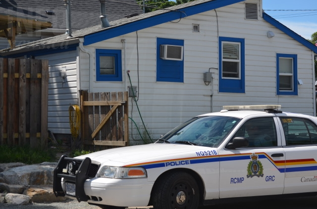 Police kept watch over Munton's house June 3, 2016.