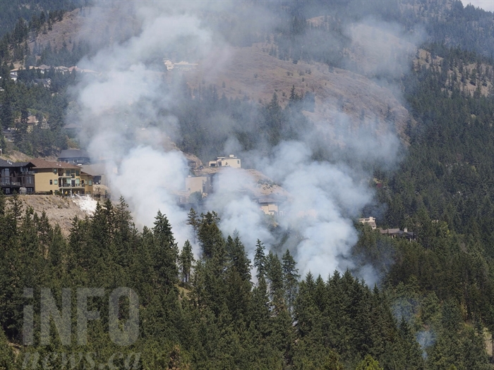 Firefighters are on the scene of a grassfire above Westside Road in West Kelowna, Friday, June 17, 2016.