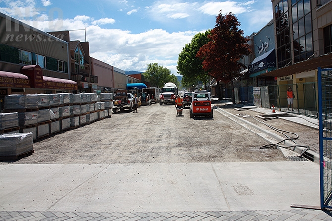 Paving stones arrive on the street in bulk for placement on the sidewalks and street intersections in this May 9 photo.