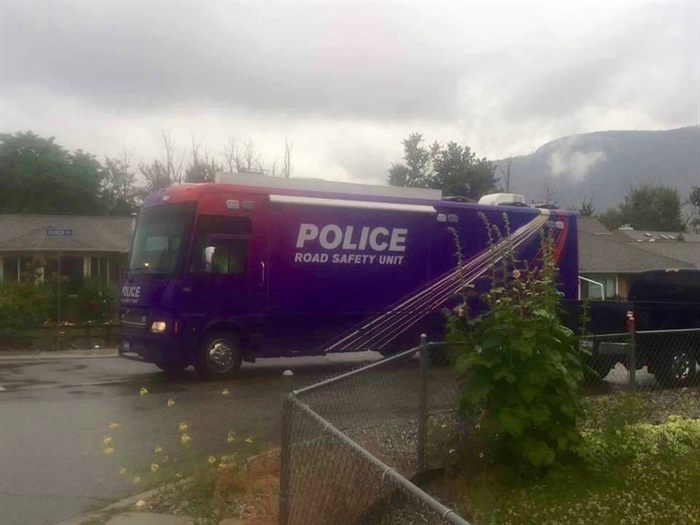 One of the police vehicles used during a massive search in Penticton, Saturday, June 18, 2016.