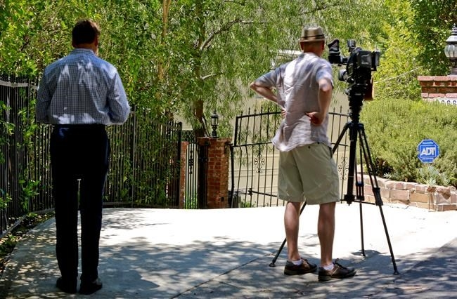 Television reporters record the driveway to the home of Anton Yeltsin, 27, in the Studio City area of Los Angeles, on Sunday, June 19, 2016. The rising actor best known for playing Chekov in the new