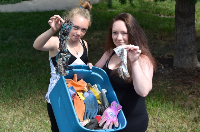 Cindy Schmidt and her daughter Shakira with some of the gloves and dog toys their cat Sketch dragged home.