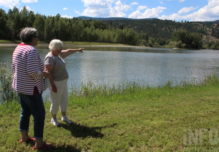 Betty Timuss points to where they spotted a girl's head bobbing in the water.