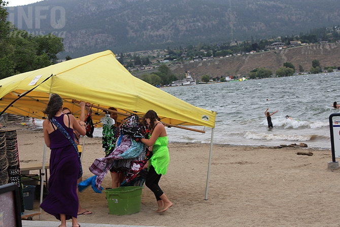 A brief wind and rain storm disrupted vendor's activities near the Peach Concession on Okanagan Lake Beach on Canada Day, Friday, July 1, 2016.