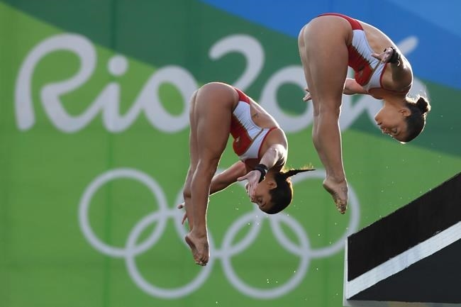 Canada's Meaghan Benfeito (left) and Roseline Filion perform in the women's synchronized 10-meter platform diving final at the 2016 Summer Olympics in Rio de Janeiro, Brazil, Tuesday, Aug. 9, 2016