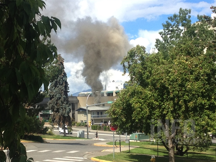 Smoke from a fire at the Travelodge motel in downtown Kamloops on Columbia Street and 4 Avenue can be seen, Wednesday, Aug. 10, 2016.