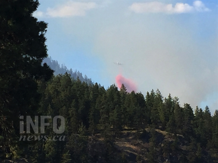 An air tanker drops a load of retardant on a wildfire burning just north of Lake Okanagan Resort on the west side of Okanagan Lake, Wednesday, Aug. 17, 2016.