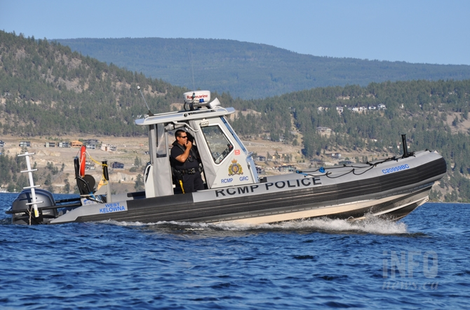 The RCMP boat from West Kelowna was called in to clear the fire area of boats so water bombers could work safely.