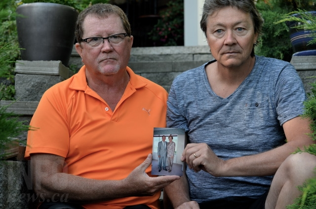 Scott and Paul May with a photo of their parents. Their father, Bill May, was killed by his roommate at a care home for patients with complex behavioural issues.