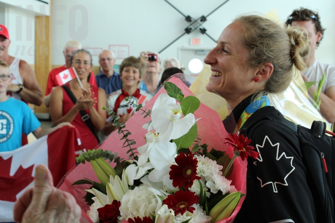Olympic bronze medal winner Catharine Pendrel arrives at the Kamloops Airport.