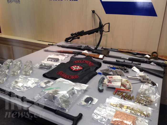 Police displayed guns and drugs confiscated from a West Kelowna home during a press conference July 13, 2016. Tyson Bone, Savanna Malone and one other man were arrested for possession for the purpose of trafficking and firearm offences.