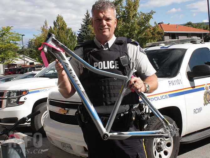 Penticton RCMP Cpl. Don Wrigglesworth displays a Jamis graphite bike frame recovered by the detachment.