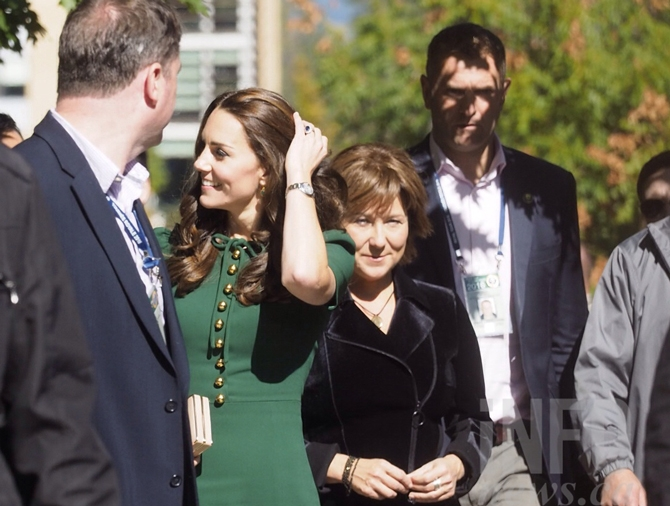 The Duchess of Cambridge was surrounded by security personnel as she made her way to ceremonies at UBC Okanagan.