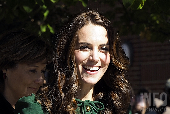 The Duchess of Cambridge smiles as she is greeted by hundreds of spectators at UBC Okanagan, accompanied by B.C. Premier Christy Clark.