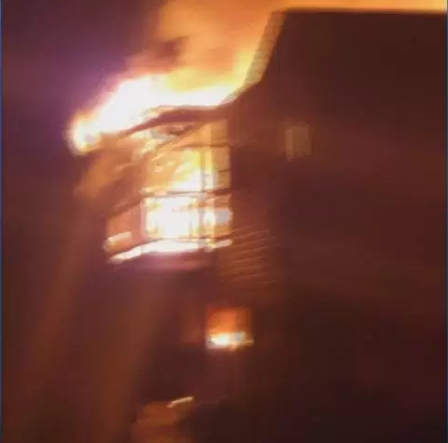 This image is a still frame from a video taken while the Kelowna home was engulfed in flames.