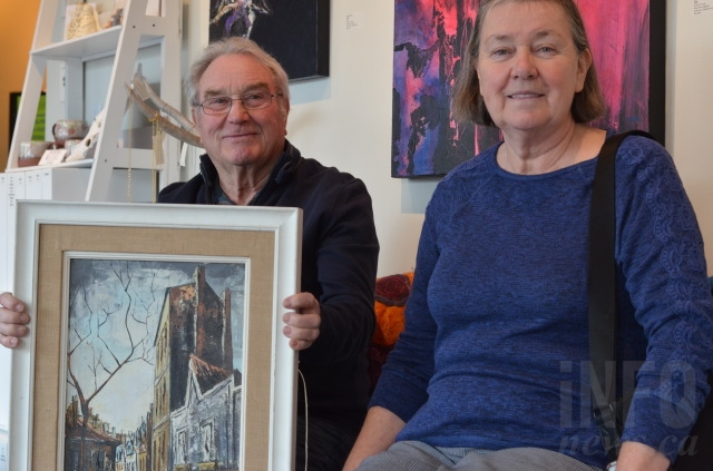 Darrell and Audrey Cliffe, from Armstrong, were pleasantly surprised at the value of this streetscape painting, at roughly $6,000 to $8,000.