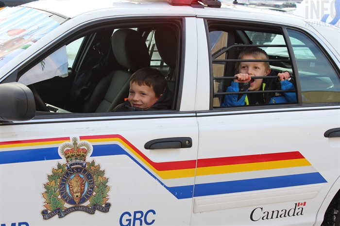 Corbin (left) and Brody (right) got to sit in the police cruiser during Kamloops RCMP's Stuff the Cruiser event on Saturday, Dec. 10, 2016.