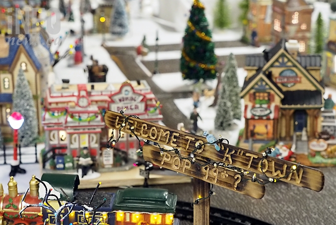 Kathy Bernard's K-Town is home to more than 100 miniature who ski, cut wood, shop, skate and visit with Santa. She creates it in her basement for her grandchildren.