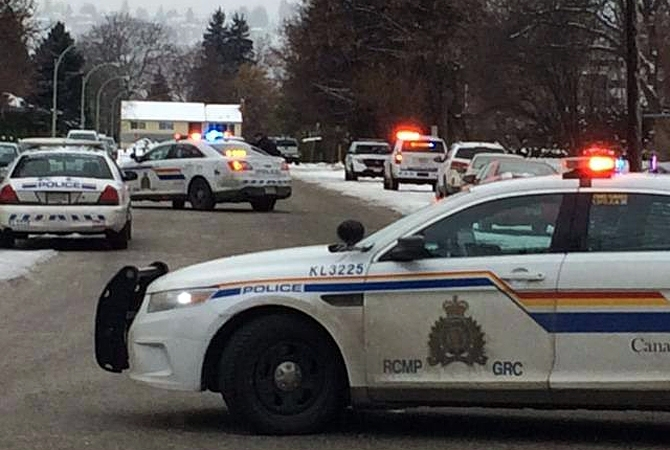Kelowna RCMP blocked of a portion of Christleton Avenue, Saturday, Dec. 26, 2015 after a targeted home invasion sent one man to hospital.