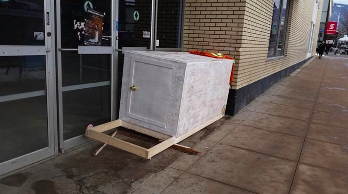 The crate was set up outside the old Liquidation World building for a while.