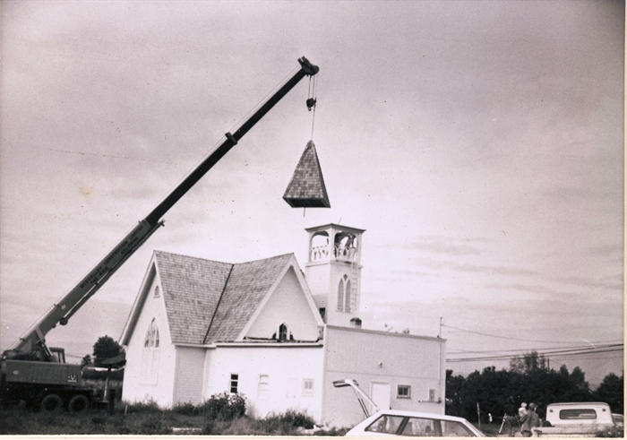 Raising the steeple of the church - date not known.