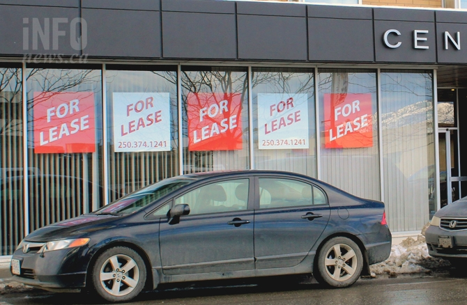 Lease signs along Seymour St. advertise empty storefront space.