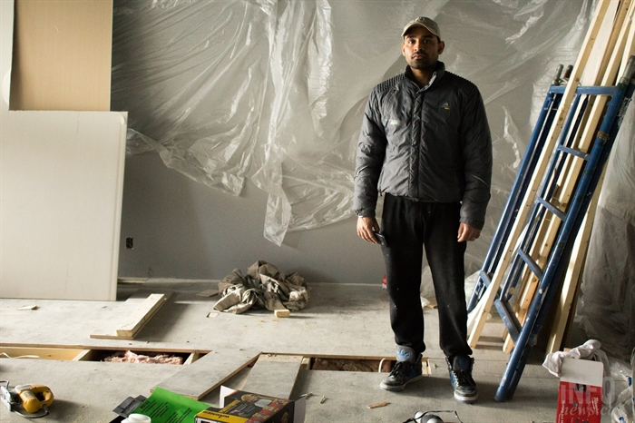 Satish Bhardwaj stands in what he hopes to be his future nail salon. It was due to open at the beginning of last month, but he says problems with the contractor delayed it.