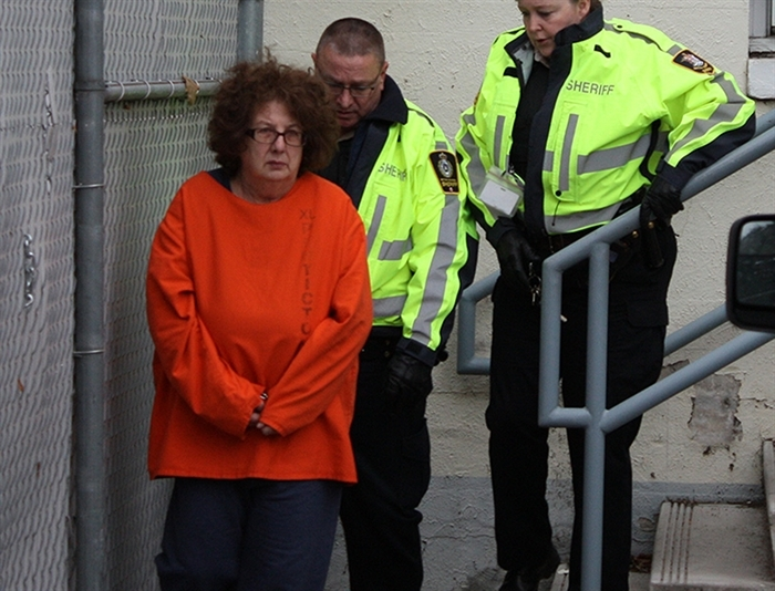 Grace Elinor Robotti is led out of Penticton courthouse after a brief appearance in 2015.