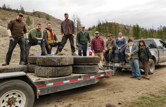 Members of the Kamloops 4x4 Club along with some tires pulled out of the Dewdrop area last year.