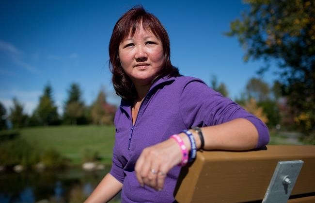 FILE PHOTO - Carol Todd sits on a bench dedicated to her late daughter Amanda Todd at Settlers Park in Port Coquitlam, B.C., on Sunday October 5, 2013. The mother of a British Columbia teenager who took her own life after enduring cyberbullying says it's
