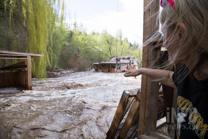 Water has completely surrounded Corine LeBourdais' tack shop on her Cherry Creek property.