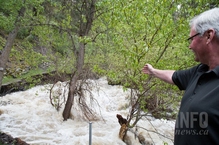 Glenn Grant says over the past 12 hours, the creek has eroded at least five feet of trail.