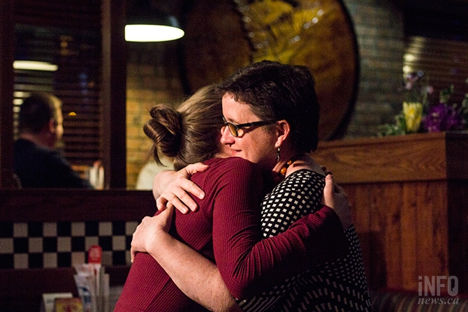 NDP candidate for the Kamloops-South Thompson, Nancy Bepple, hugs a supporter at an event after conceding to Todd Stone.