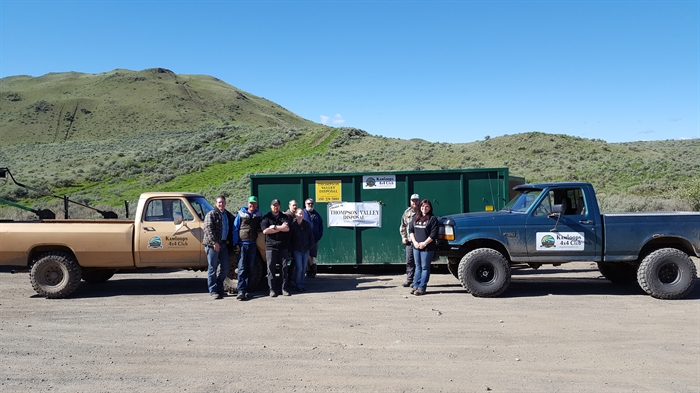 Volunteers nearly filled this 40 yard bin donated by Thompson Valley Disposal.