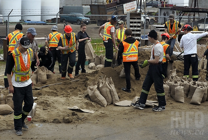 Rutland Secondary students volunteer filling sand bags at a location on Adams Road, Thursday, May 11, 2017.
