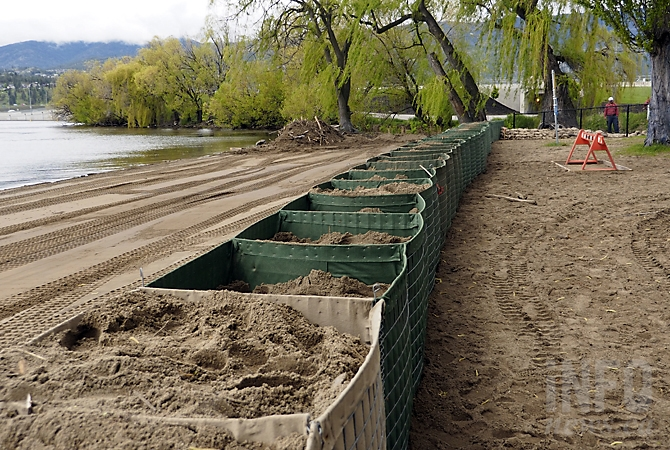 FILE PHOTO - Square baskets filled with sand are set up at the Lake Avenue Beach access in Kelowna, May 16, 2017.
